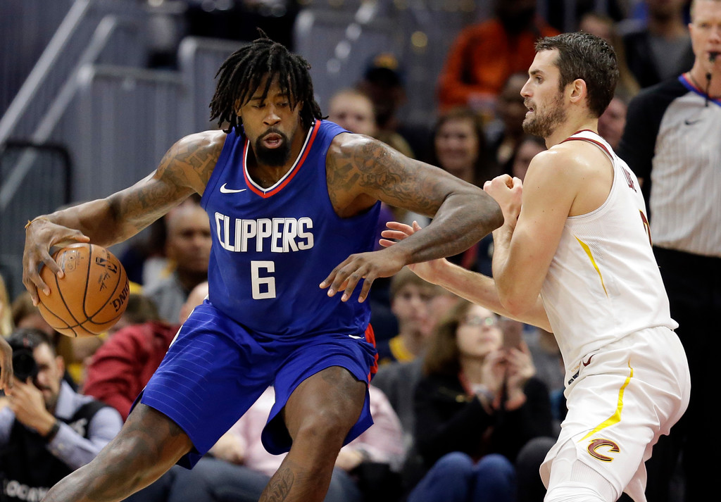 . Los Angeles Clippers\' DeAndre Jordan (6) drives against Cleveland Cavaliers\' Kevin Love (0) in the first half of an NBA basketball game, Friday, Nov. 17, 2017, in Cleveland. (AP Photo/Tony Dejak)