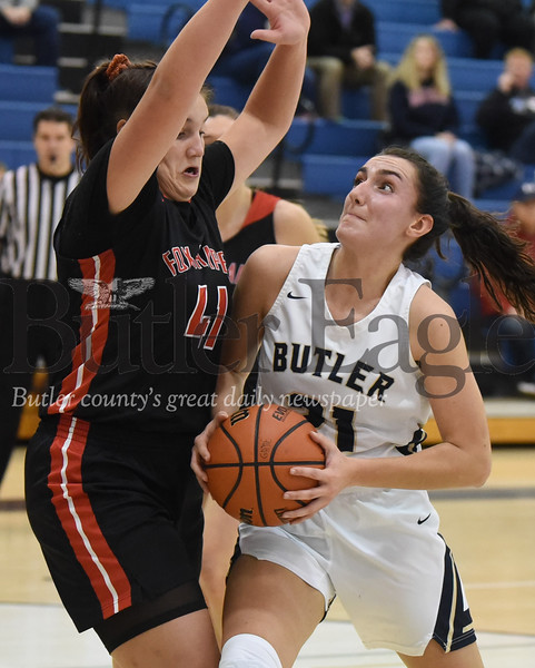 Butler's Alison Altman drives to the hoop against Fox Chapel's Ellie Schwartzman in Thursday night's home game. The Golden Tornado fell to the Foxes 56-51 in the game's closing minutes. Seb Foltz/Butler Eagle
