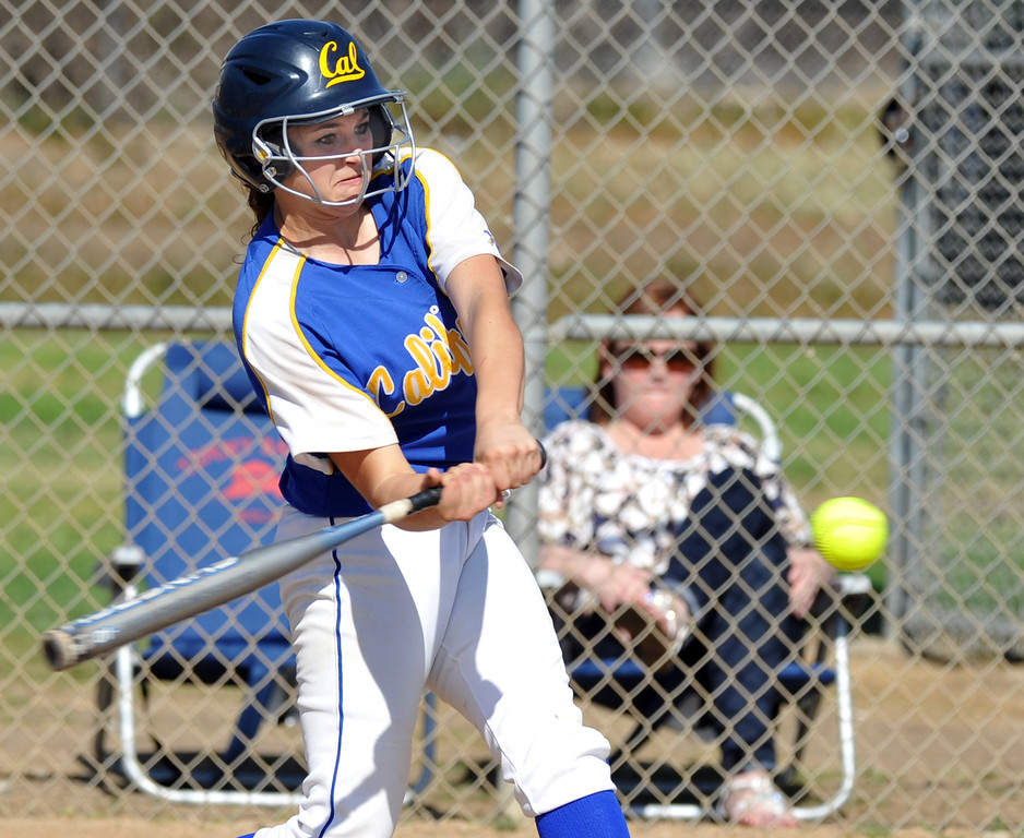 . California\'s Trisha Trujillo (#24) hits a three-run homerun as they play Bell Gardens in their non-league game at California High School in Whittier on Thursday March 14, 2013. California beat Bell Gardens 10-0 in five innings. (SGVN/Staff Photo by Keith Durflinger)
