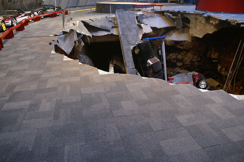 National Corvette Museum Skydome Sinkhole: 1962 Black Corvette can be seen in the sinkhole and the tip of the 1993 Ruby Red 40th Anniversary Corvette 1 millionth can be spotted under the slab of concrete underneath the '62.   Permission given to use this image with credit to the National Corvette Museum