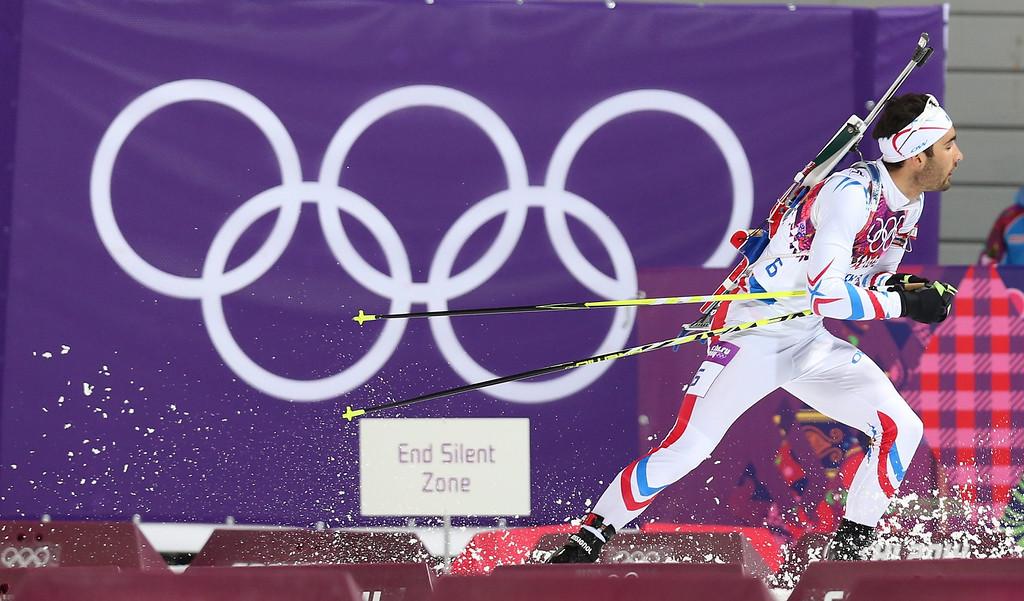 . epa04067206 Martin Fourcade of France in action during the Men\'s 12.5 km Pursuit in Laura Cross-country Ski & Biathlon Center at the Sochi 2014 Olympic Games, Krasnaya Polyana, Russia, 10 February 2014.  EPA/ARMANDO BABANI