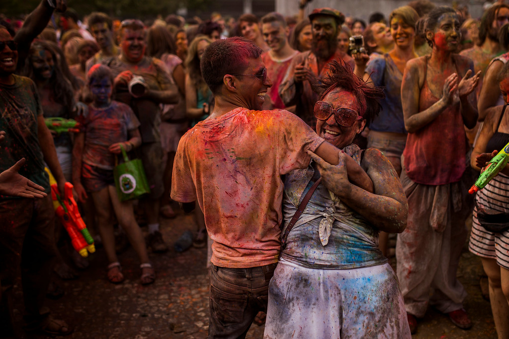 . Revelers dance after throwing  colored powders on each other during a Monsoon Holi Festival in Madrid, Spain, Saturday, Aug. 9, 2014. (AP Photo/Andres Kudacki)
