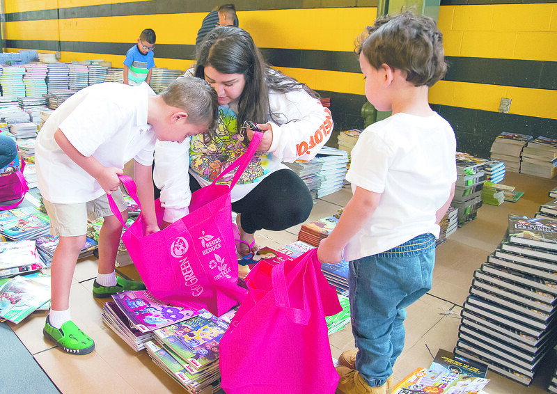 09/04/19  Wesley Bunnell | Staff  Twenty two thousand books were donated to area educators and parents with children by ESPN and Disney on Thursday September 4, 2019 at New Britain Stadium. Dayanara Gonzalez helps her sons Noah Morales, L,  and Isaac Morales choose books to bring home.
