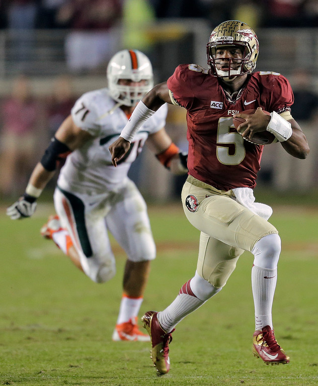 . In this Nov. 2, 2013 file photo, Florida State quarterback Jameis Winston (5) outruns Miami defensive lineman Anthony Chickillo (71) during the first quarter of an NCAA college football game, in Tallahassee, Fla. Winston envisioned winning the Heisman Trophy before signing with the top-ranked Seminoles. (AP Photo/Chris O\'Meara, File)