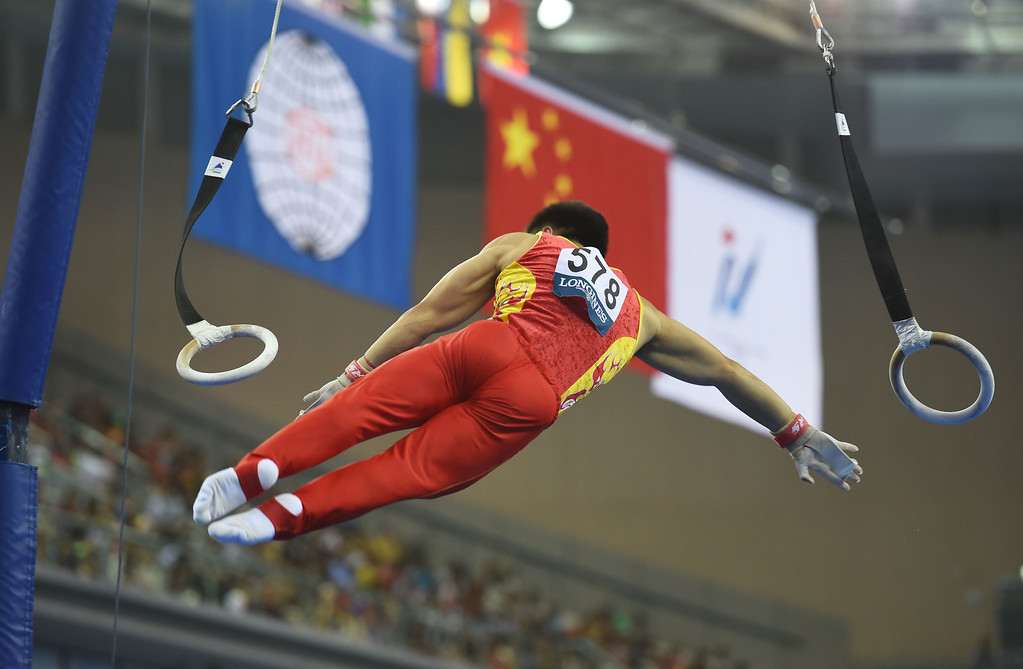 . China\'s Liu Yang performs on the rings during the men\'s qualification at the Gymnastics World Championships in Nanning, in China\'s southern Guangxi province on October 3, 2014. GREG BAKER/AFP/Getty Images