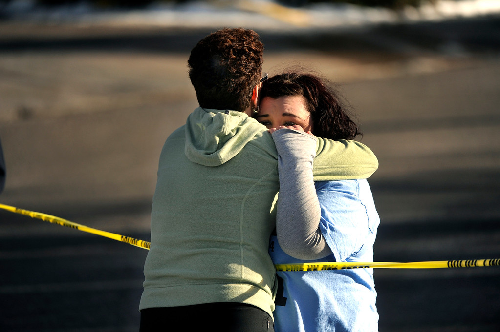 . CENTENNIAL, CO. - DECEMBER 13: Kathy Boyle hugged her daughter Alex over police tape outside Arapahoe High School Friday afternoon, December 13, 2013. Her daughter is a senior at the school. A shooting inside the school sent hundreds of students rushing for safety. Photo By Karl Gehring/The Denver Post