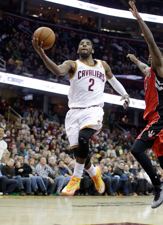 . Cleveland Cavaliers\' Kyrie Irving jumps to the basket during an NBA basketball game against the Toronto Raptors Tuesday, Feb. 25, 2014, in Cleveland. (AP Photo/Tony Dejak)