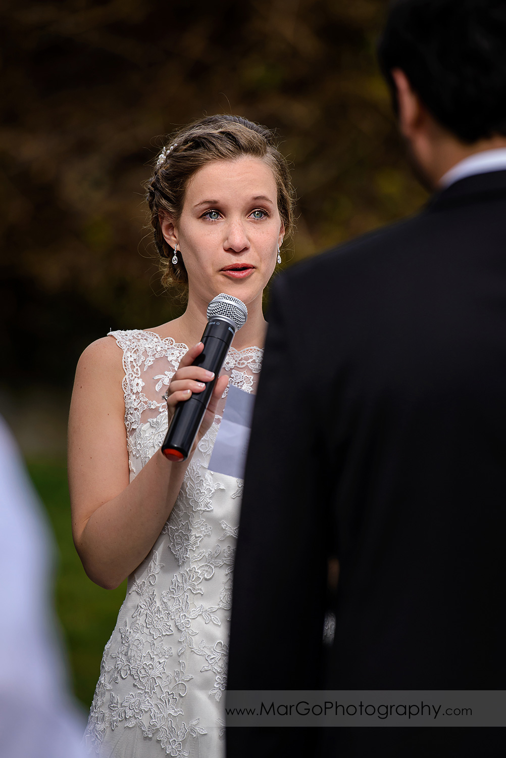 bride saying vows during wedding ceremony at Fremont Century House & Gardens