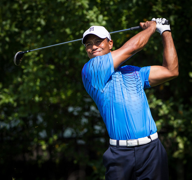 Tiger Woods hits his tee ball on 12 during first round action at the BMW Championship at Crooked Stick CC in Carmel Indiana on Thursday Sept. 6, 2012. (Charles Cherney/WGA)