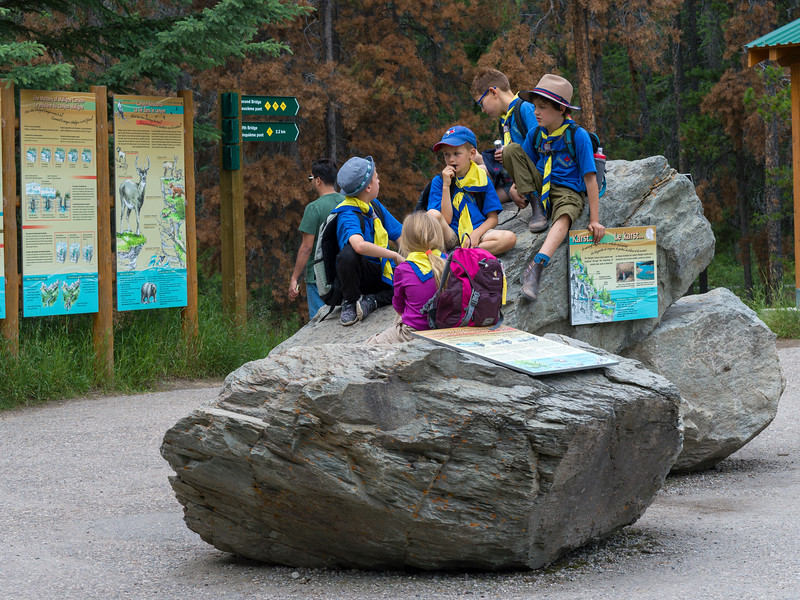 Schoolchildren sitting on rocks, Maligne Canyon, Jasper National Park, Jasper, Alberta, Canada