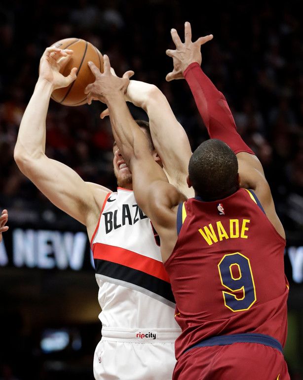 . Cleveland Cavaliers\' Dwyane Wade (9) knocks the ball loose from Portland Trail Blazers\' Pat Connaughton (5) in the first half of an NBA basketball game, Tuesday, Jan. 2, 2018, in Cleveland. (AP Photo/Tony Dejak)