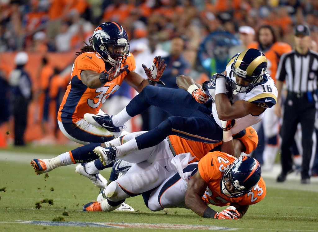 . DENVER, CO. - AUGUST 17: St. Louis Rams wide receiver Emory Blake (16) gets pounded by Denver Broncos Quentin Jammer (23) during the third quarter August 24, 2013 at Sports Authority Field at Mile High. (Photo By John Leyba/The Denver Post)