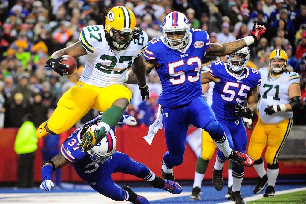 . Green Bay Packers running back Eddie Lacy (27) is chased by Buffalo Bills\' Nigel Bradham (53) and Nickell Robey (37) in the end zone during the second half of an NFL football game Sunday, Dec. 14, 2014, in Orchard Park, N.Y. Lacy was tackled in the end zone for a safety. The Bills won the game 21-13.(AP Photo/Gary Wiepert)