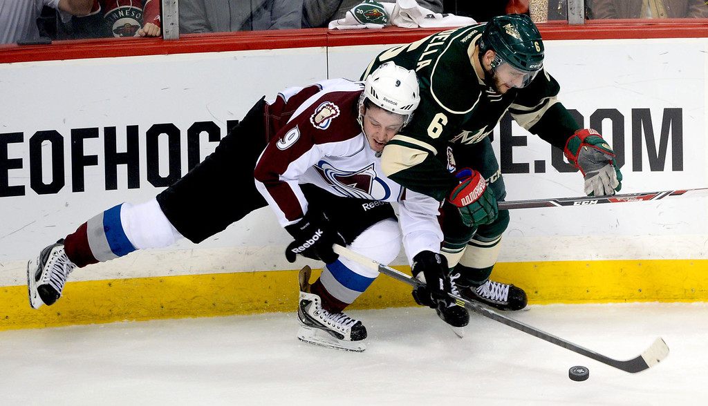 . Minnesota\'s  Marco Scandella and Colorado\'s Matt Duchene collide during the first period.  (Pioneer Press: Sherri LaRose-Chiglo)