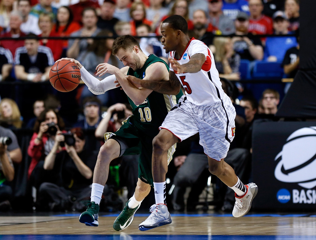 . LEXINGTON, KY - MARCH 23: Wes Eikmeier #10 of the Colorado State Rams handles the ball against Kevin Ware #5 of the Louisville Cardinals in the second half during the third round of the 2013 NCAA Men\'s Basketball Tournament at Rupp Arena on March 23, 2013 in Lexington, Kentucky.  (Photo by Kevin C. Cox/Getty Images)