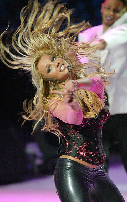 . US singer Britney Spears performs during the NRJ awards ceremony, Saturday, Jan. 24, 2004, in Cannes , southern France. (AP Photo/Bruno Bebert, POOL)