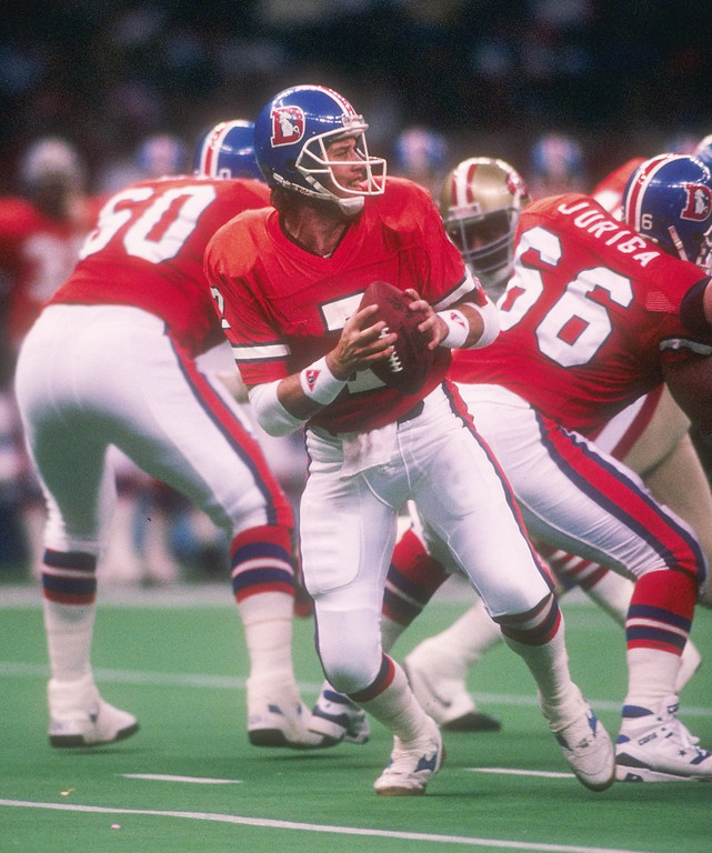 . Quarterback John Elway #7 of the Denver Broncos looks to pass during the Super Bowl XXIV against the San Francisco 49ers at the Louisiana Superdome in New Orleans, Louisiana.   (Rick Stewart/Allsport)
