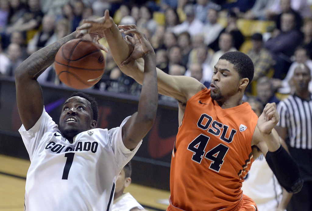 . Colorado\'s Wesley Gordon is fouled by Oregon State\'s Devon Collier while going for a shot during an NCAA college basketball game Thursday, Jan. 2, 2014, in Boulder, Colo. Jeremy Papasso/Daily Camera