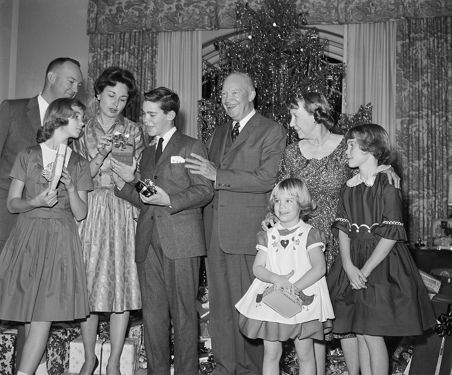 . President Eisenhower poses with members of his family during a Christmas Eve picture taking session in the west sitting room of the second floor residence section of the White House in Washington on Dec. 24, 1960. From left: Lt. Col. John Eisenhower; Barbara Anne, 11, in front; Mrs. John Eisenhower, David 12, the President, Mrs. Eisenhower, Mary Jean, 5, in front, and Susan, 9. (AP Photo/Henry Griffin )
