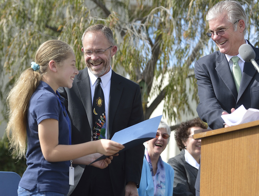 . LONG BEACH, CALIF. USA -- Seventh grader Luci West, with LBUSD Superintendent of Schools Christopher Steinhauser, center, accepts a Green Ribbon nomination for Hughes Middle School from California Superintendent of Public Instruction Tom Torlakson, right, on February 15, 2013, in Long Beach, Calif. Torlakson was at the school to announce  the 2013 nominees � four schools and one school district � to compete in the second year of the U.S. Department of Education�s Green Ribbon School. Photo by Jeff Gritchen / Los Angeles Newspaper Group