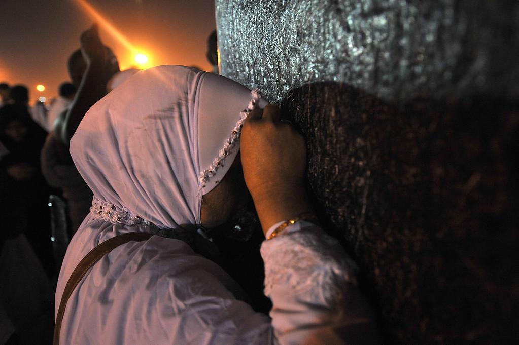 . A Muslim pilgrim prays on top of Mount Arafat, near the holy city of Mecca, ahead of the hajj main ritual, on October 14, 2013. Pilgrims in their hundreds of thousands thronged Mount Arafat in Saudi Arabia from early morning for the climax of the annual hajj pilgrimage, arriving on foot, by train or in vehicles. AFP PHOTO/FAYEZ NURELDINE/AFP/Getty Images