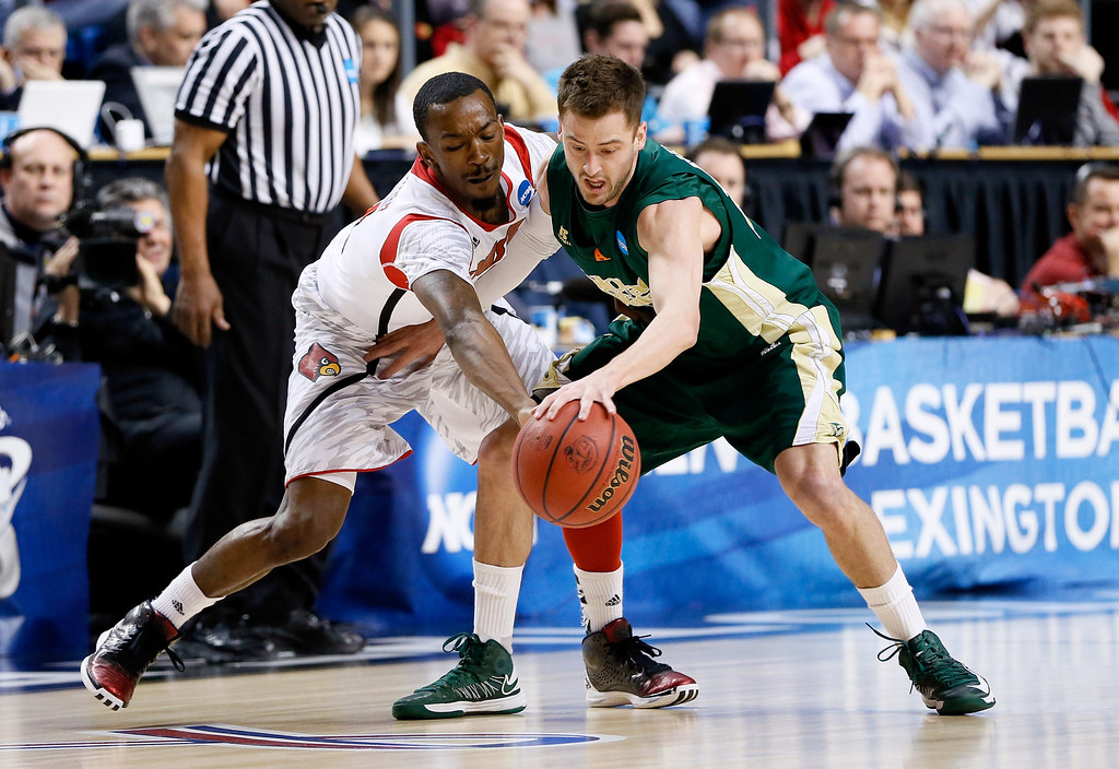 . LEXINGTON, KY - MARCH 23: Russ Smith #2 of the Louisville Cardinals tries to strip the ball from Wes Eikmeier #10 of the Colorado State Rams in the first half during the third round of the 2013 NCAA Men\'s Basketball Tournament at Rupp Arena on March 23, 2013 in Lexington, Kentucky.  (Photo by Kevin C. Cox/Getty Images)
