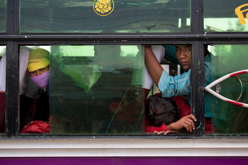 . Nepalese people look out from inside a bus where they have taken shelter as it is considered safer in cars than inside houses with repeated aftershocks, in Kalanki neighbourhood of Kathmandu, Nepal, Sunday, April 26, 2015. A powerful aftershock shook Nepal on Sunday, making buildings sway and sending panicked Kathmandu residents running into the streets a day after a massive earthquake devastated the region and destroyed homes and infrastructure. (AP Photo/Bernat Armangue)