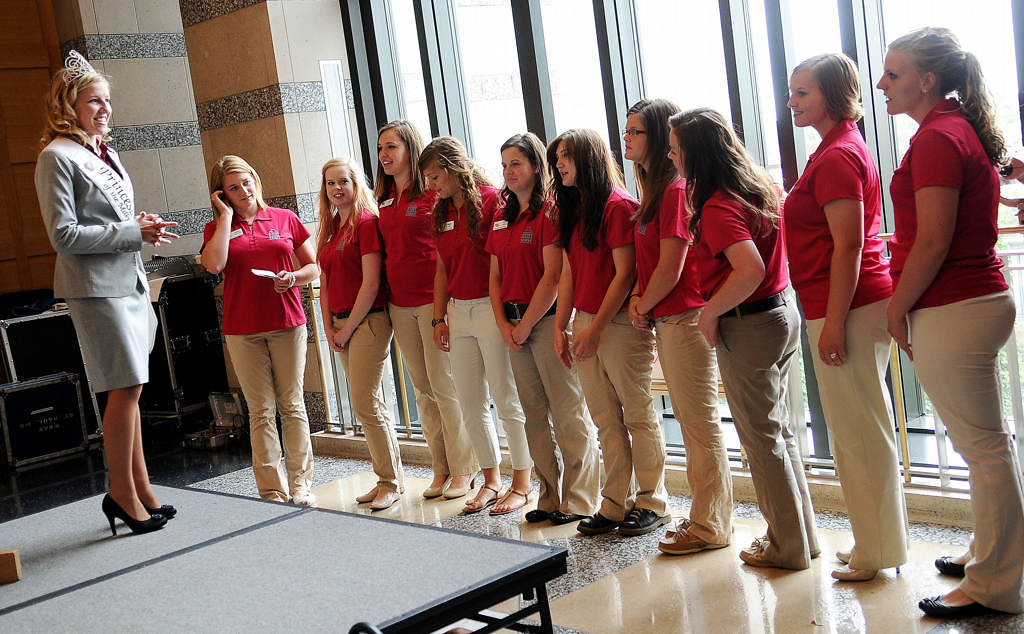 . Current Princess Kay of the Milky Way Christine Reitsma, left, talks with 10 of the 12 Princess Kay candidates from all over Minnesota before the start of the ceremony. (Pioneer Press: Sherri LaRose-Chiglo)