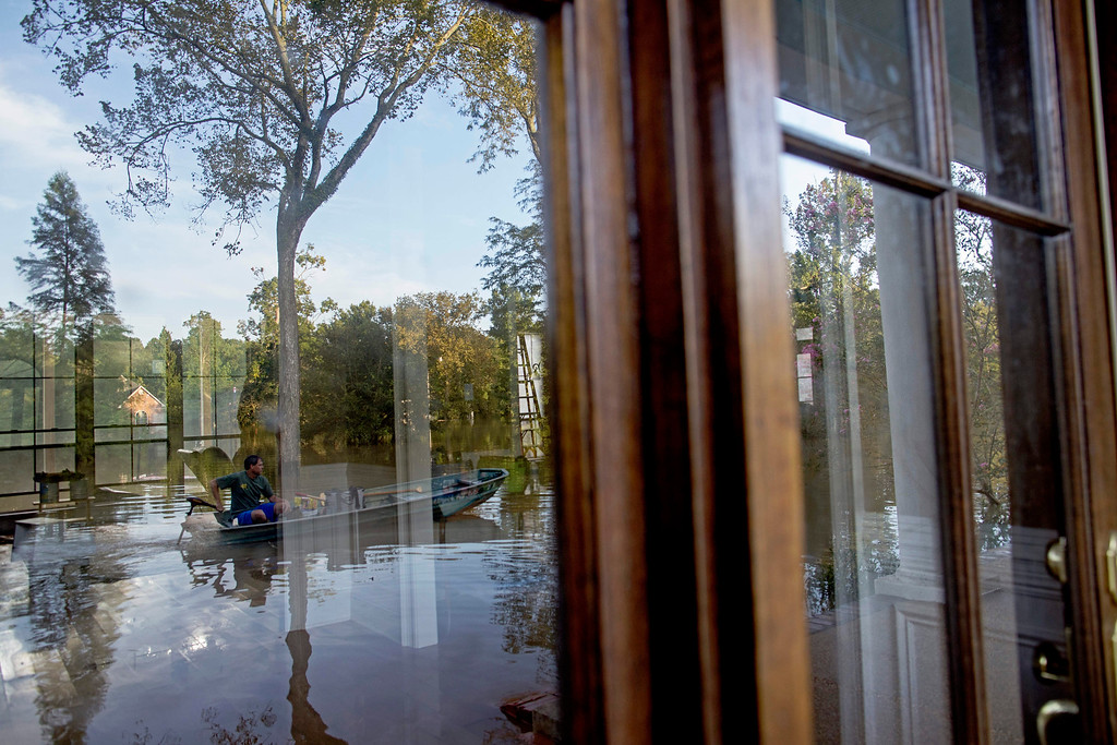 . David Key arrives at his flooded home in Prairieville, La., Tuesday, Aug. 16, 2016. Key, an insurance adjuster, fled his home as the flood water was rising with his wife and three children and returned today to assess the damage. (AP Photo/Max Becherer)