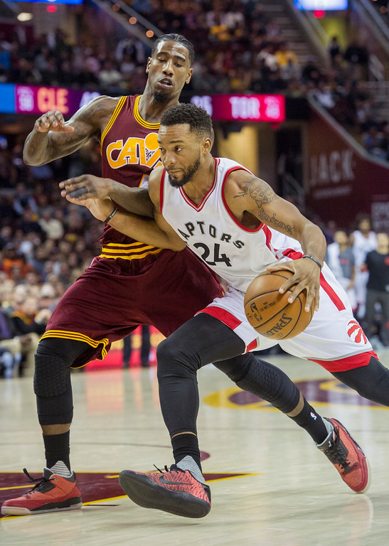 . Toronto Raptors\' Norman Powell (24) drives past Cleveland Cavaliers\' Iman Shumpert during the second half of an NBA basketball game in Cleveland, Tuesday, Nov. 15, 2016. The Cavaliers won 121-117. (AP Photo/Phil Long)