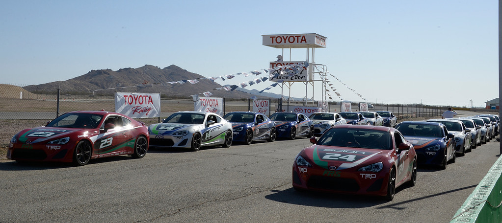 . March 15,2014. Rosamond CA. Toyota race cars are lineup and ready, as celebrities in the Long Beach Grand Prix practice racing with instructors in Toyota race cars at the Willow Springs International Raceway Saturday.  photo by Gene Blevins/LA DailyNews