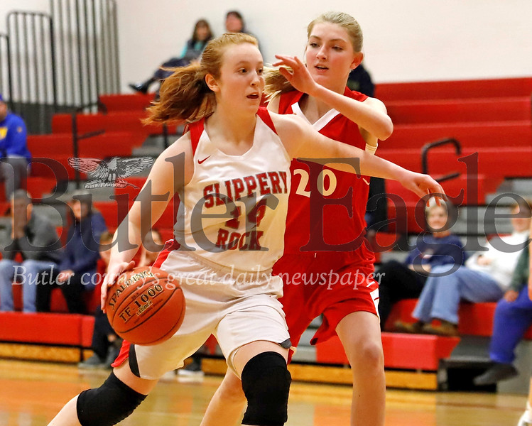 Slippery Rock's Hallie Raabe drives to the hoop against West Middlesex's Kennedy Beatty. The Rockets fought back from a more than 10 point deficit to top West Middlesex 55-51. Seb Foltz/Butler Eagle