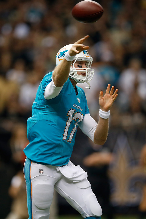 . Quarterback Ryan Tannehill #17 of the Miami Dolphins throws the ball in the first quarter against the New Orleans Saints at the Mercedes-Benz Superdome on September 30, 2013 in New Orleans, Louisiana.  (Photo by Chris Graythen/Getty Images)