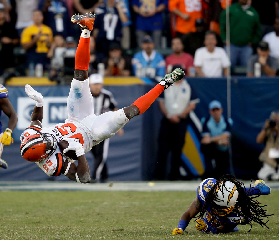 . Cleveland Browns tight end David Njoku, left, is tackled by Los Angeles Chargers free safety Tre Boston during the second half of an NFL football game Sunday, Dec. 3, 2017, in Carson, Calif. (AP Photo/Jae C. Hong)