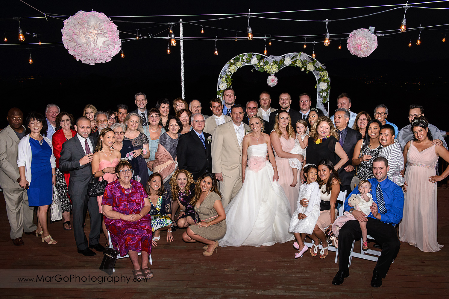 night portrait of wedding party with bride and groom in the middle