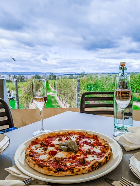 lightfoot and wolfville pizza in winery.jpg