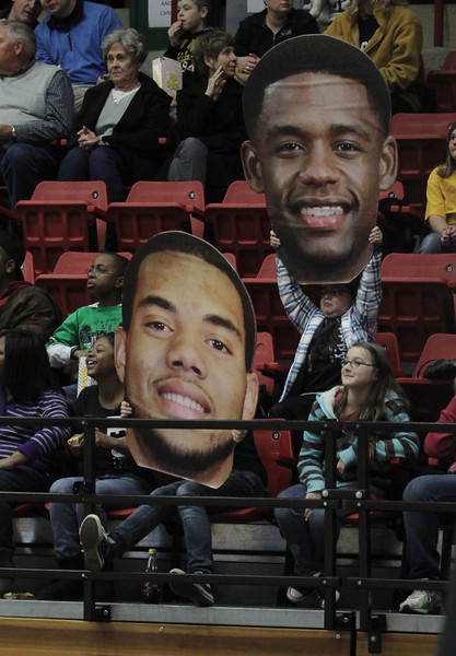 Kings Mountain Intermediate fans hold up huge pictures of the two seniors to show support