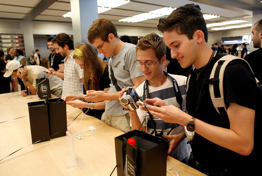 . Customers try out the new Apple  iPhone inside the Apple Store Friday, June 29, 2007 in New York.   (AP Photo/Jason DeCrow)