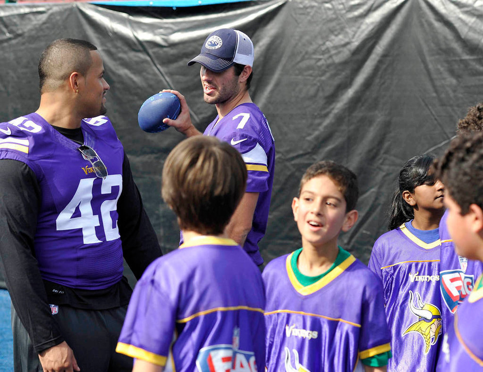 . Vikings fullback Jerome Felton, left, talks to teammate Christian Ponder during a football clinic at Wembley Stadium Tuesday. (NFL: Sean Ryan)