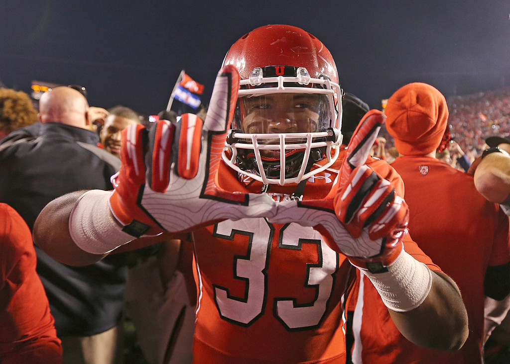. SALT LAKE CITY, UT - OCTOBER 12: Marcus Sanders-Williams #33 of the Utah Utes celebrates their upset win over the Stanford Cardinal during the first half of an NCAA football game October 12, 2013 at Rice Eccles Stadium in Salt Lake City, Utah. Utah Beat Stanford 27-21. (Photo by George Frey/Getty Images)