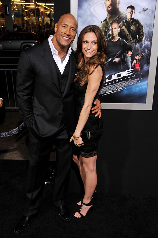 """. Dwayne Johnson, a cast member in \""""G.I. Joe: Retaliation,\"""" poses with his girlfriend Lauren Hashian at the Los Angeles premiere of the film at the TCL Chinese Theatre on Thursday, March 28, 2013 in Los Angeles. (Photo by Chris Pizzello/Invision/AP)"""