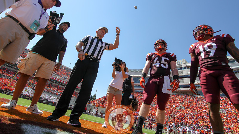 RB Sam Rogers (45) and DB Chuck Clark (19) watch the coin toss before the opening kick. (Mark Umansky/TheKeyPlay.com)