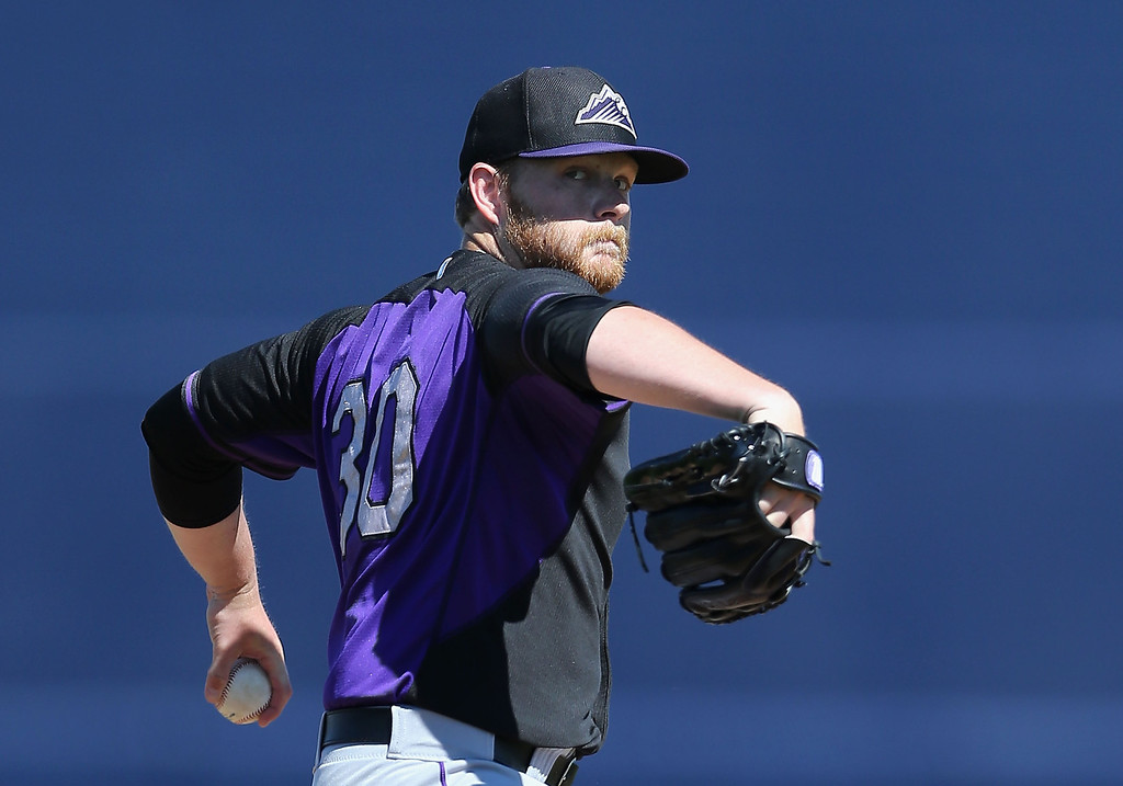 . Starting pticher Brett Anderson #30 of the Colorado Rockies pitches against the Seattle Mariners during the spring training game at Peoria Stadium on March 3, 2014 in Peoria, Arizona.  (Photo by Christian Petersen/Getty Images)