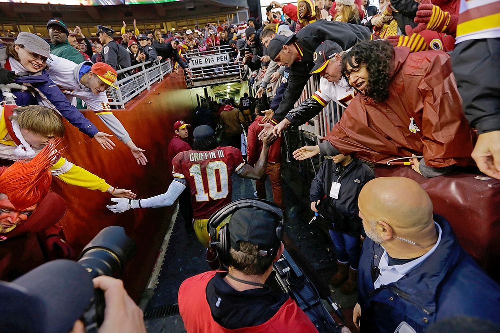 Description of . Washington Redskins quarterback Robert Griffin III leaves the field after their 31-28 overtime win over the Baltimore Ravens in an NFL football game in Landover, Md., Sunday, Dec. 9, 2012. (AP Photo/Alex Brandon)