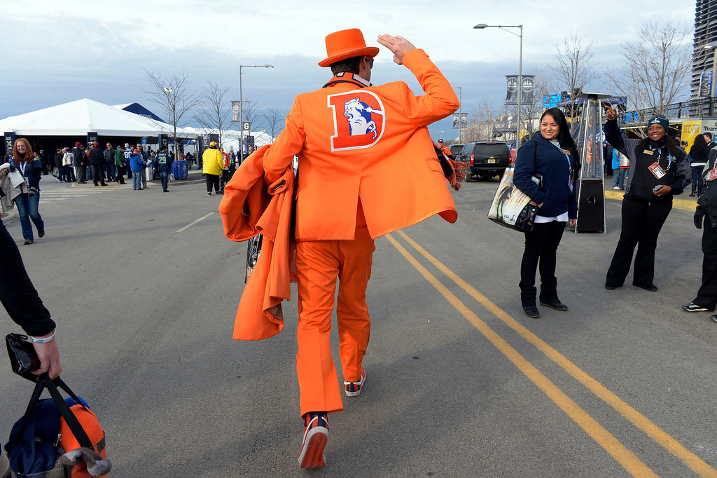 . Tom Harrington of Denver, Colorado sports his Broncos tuxedo on his way into the stadium prior to the game.  Harrington predicts a 34 to 24 Broncos victory.  The Denver Broncos vs the Seattle Seahawks in Super Bowl XLVIII at MetLife Stadium in East Rutherford, New Jersey Sunday, February 2, 2014. (Photo by Craig Walker/The Denver Post)