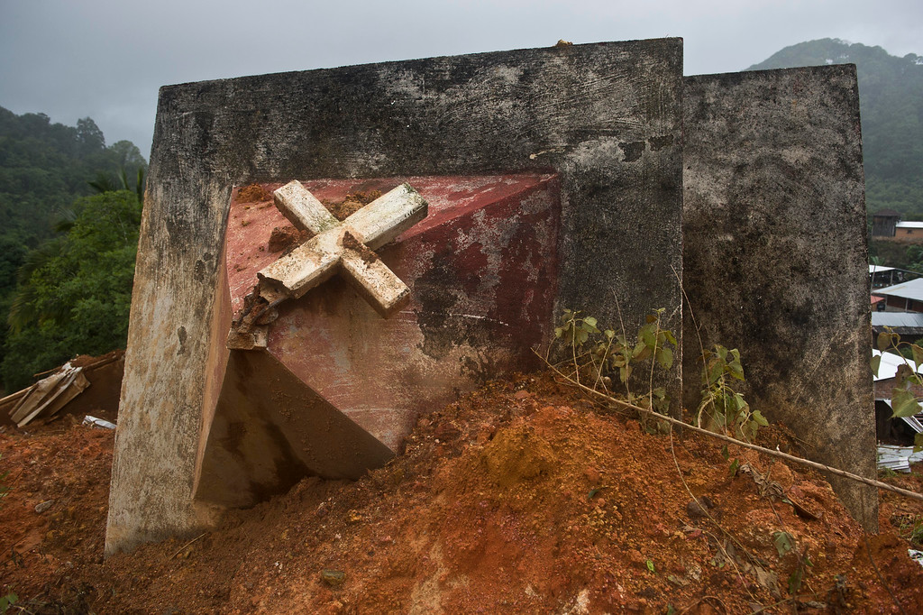 . The remains of a the tower of the church can be seen after a landslide in La Pintada, state of Guerrero, Mexico, on September 19, 2013 as heavy rains hit the country.   AFP PHOTO/RONALDO Schemidt/AFP/Getty Images