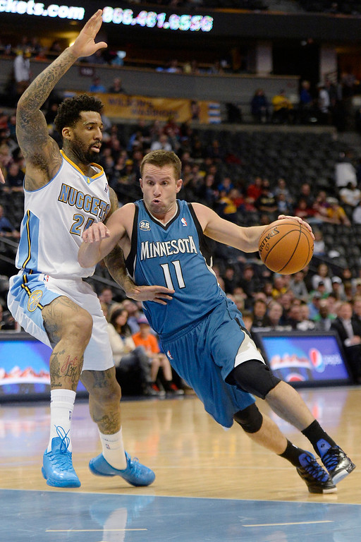 . J.J. Barea (11) of the Minnesota Timberwolves drives on Wilson Chandler (21) of the Denver Nuggets during the second half.   (Photo By AAron Ontiveroz/The Denver Post)