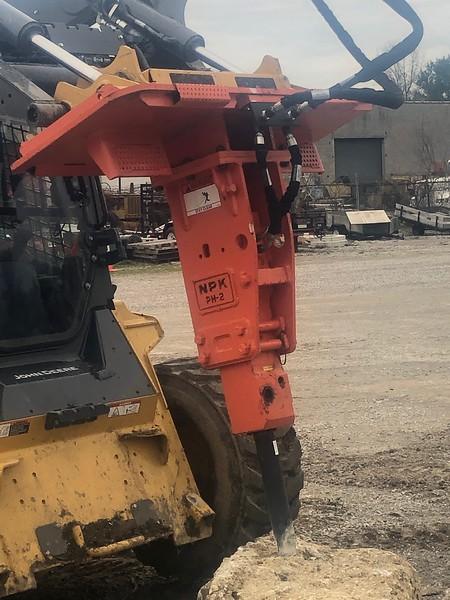 NPK PH2 hydraulic hammer on 332 Deere skid steer - Village of New London, OH  4-20 (5).jpg