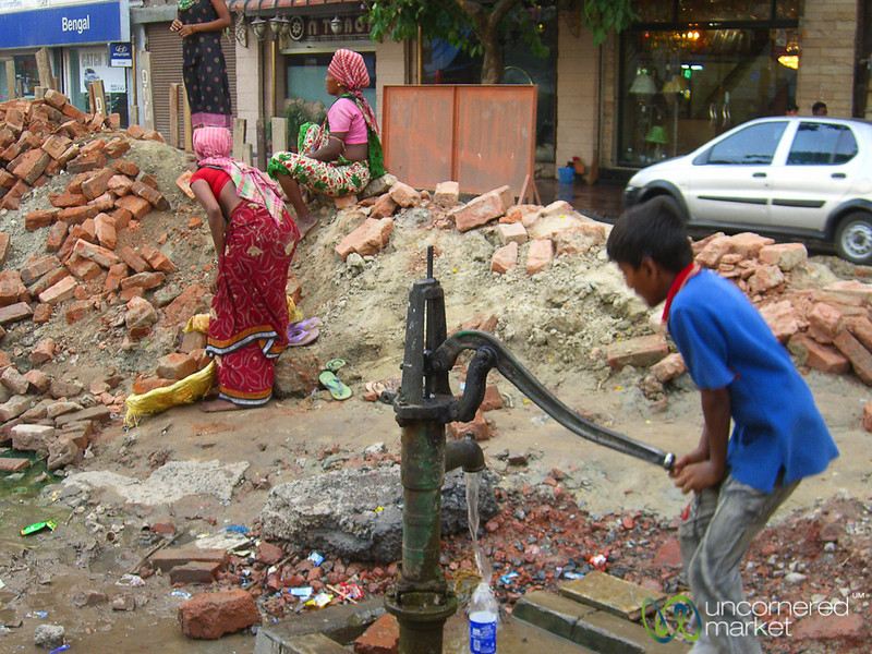 A Boy Tries to Fill is Water Bottle - Kolkata, India