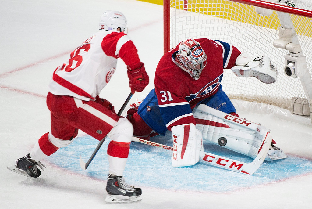 . Montreal Canadiens goaltedner Carey Price makes a save against Detroit Red Wings\' Tomas Jurco during first period NHL hockey action in Montreal, Tuesday, Oct. 21, 2104. (AP Photo/The Canadian Press, Graham Hughes)